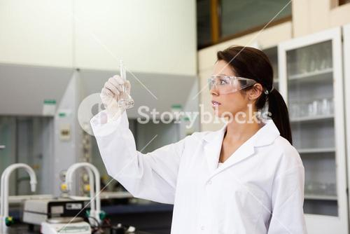 Chemist looking at a Erlenmeyer flask