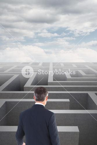 Businessman standing in front of a maze