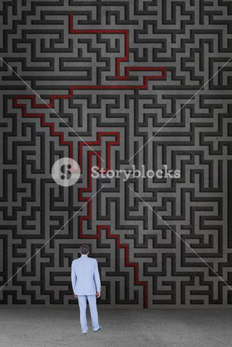 Businessman standing in front a maze