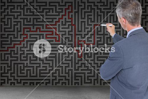Businessman drawing a red line