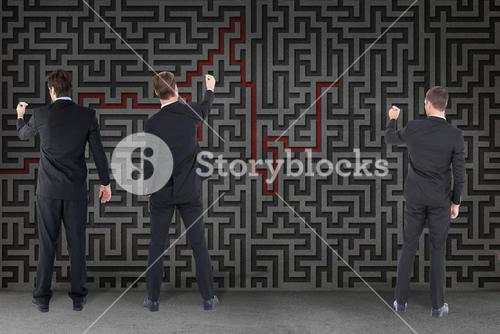 Businessmen drawing a red line