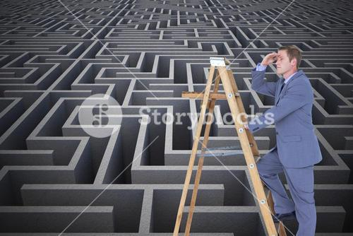 Businessman standing on a ladder