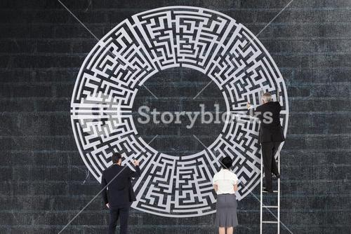 Business people drawing a maze