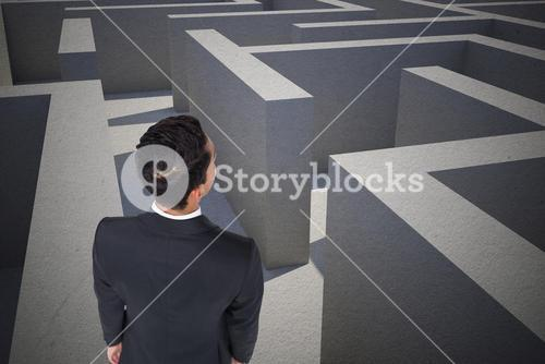 Businessman standing in a maze