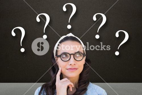 Thoughtful woman with question marks