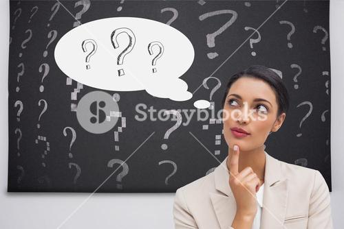 Thoughtful businesswoman with a question mark