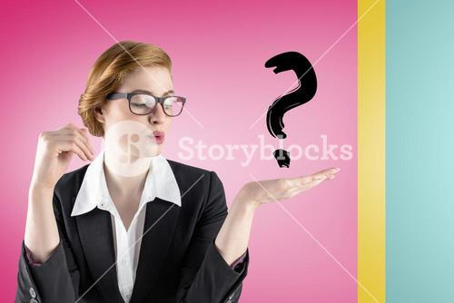 Businesswoman holding a question mark