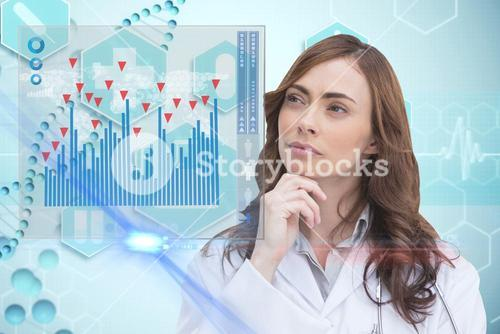 Doctor pointing on medical graph hologram