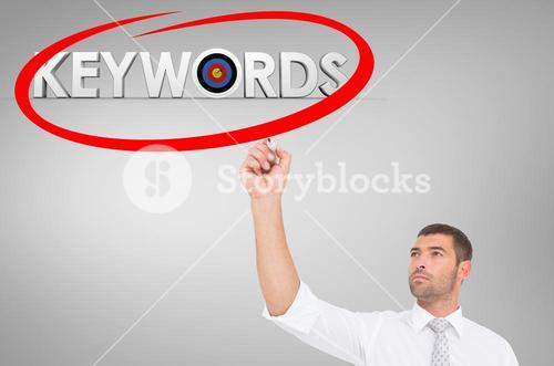 Businessman circling the word keywords