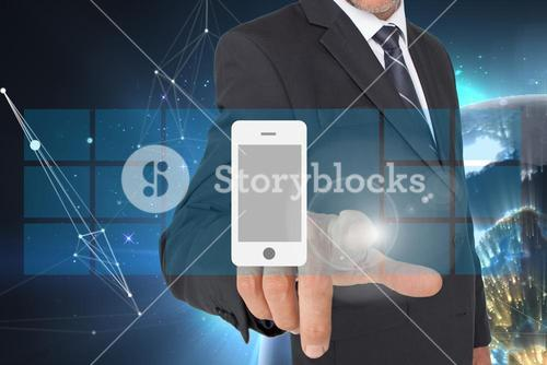 Businessman pointing on a smartphone hologram