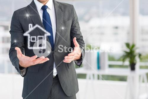 Businessman holding a house icon