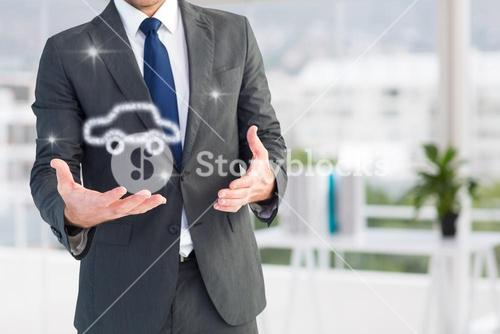 Businessman holding a car icon