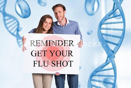 Couple holding a sign with reminder get your flu shot