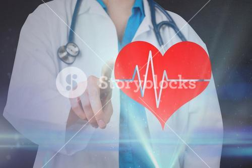 Doctor pointing on a heart hologram