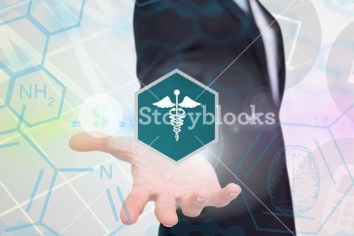 Businessman holding a medical icon