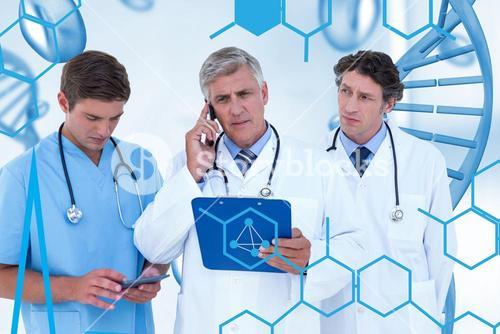 Doctors using technology and clipboard