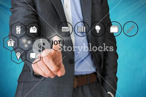 Businessman pointing on internet of things icons