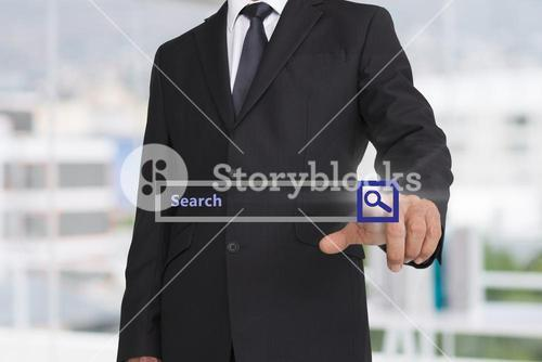 Businessman pointing on search field hologram