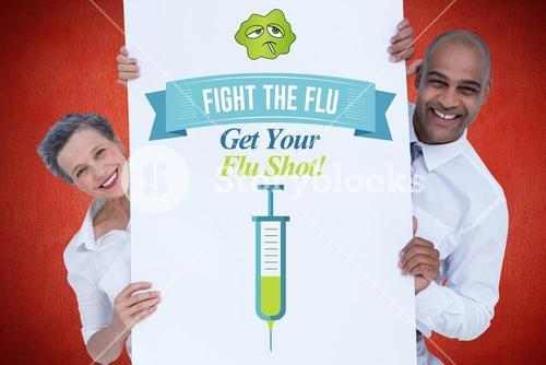 Business people holding fight the flu sign