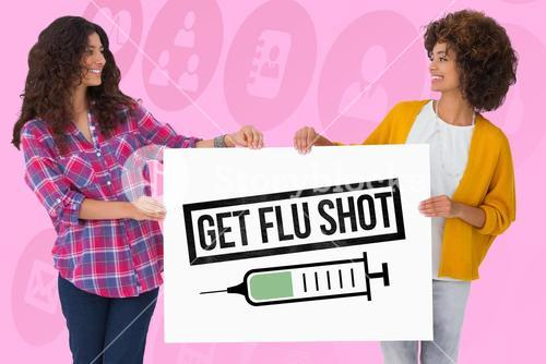 Women holding a get flu shot sign