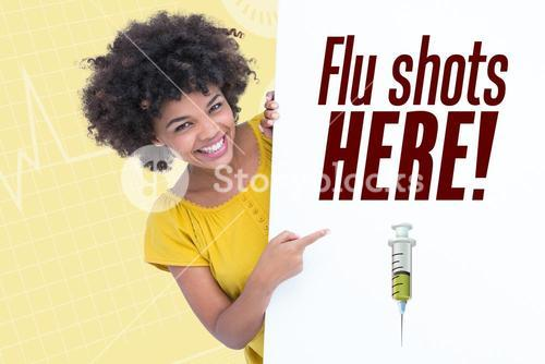 Woman pointing on flu shots here sign