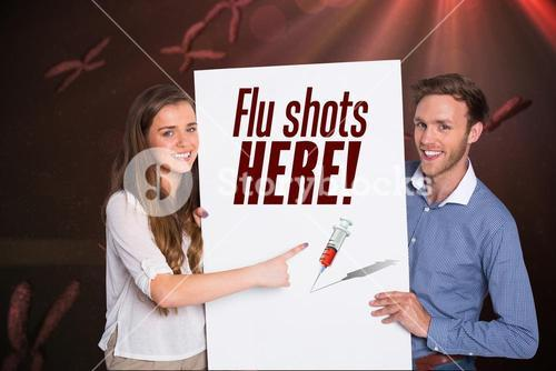 Young couple holding flu shots here sign