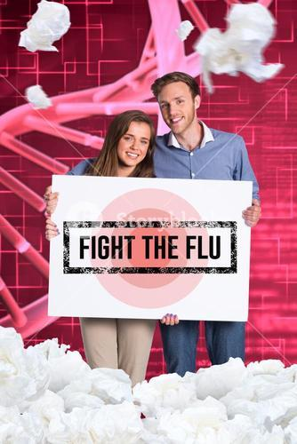 Young couple holding fight the flu sign