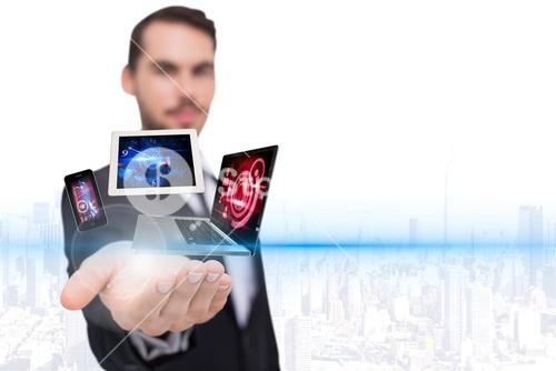 Businessman holding technology hologram