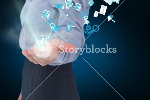 Businesswoman holding tech icons