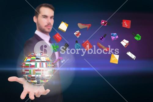 Businessman holding flagged earth hologram