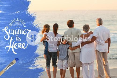 Extended family hugging at the beach
