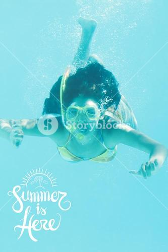 Young woman diving in the water