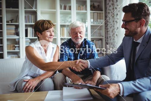 Financial advisor shaking hands with senior woman