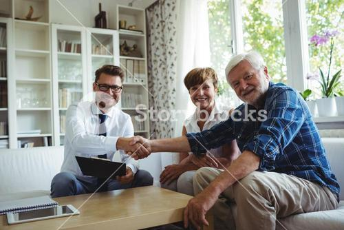 Financial advisor shaking hands with senior man
