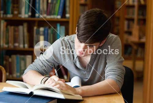 Focused male student working