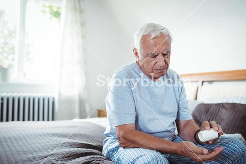 Senior man taking medicines