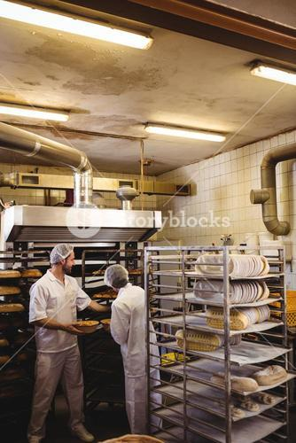 Male and female baker working together
