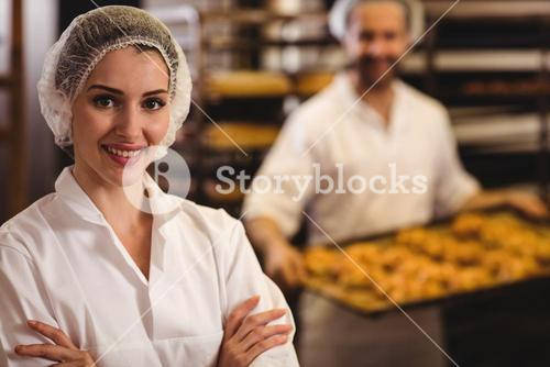 Portrait of female baker smiling