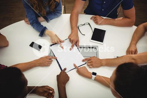 Business executives pointing on clipboard