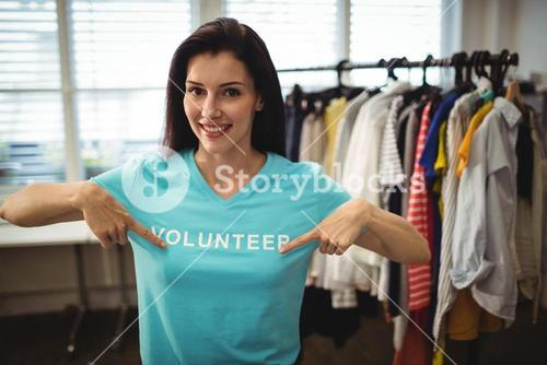 Female volunteer showing text her t-shirt