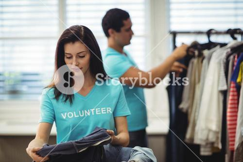 Female volunteer checking clothes