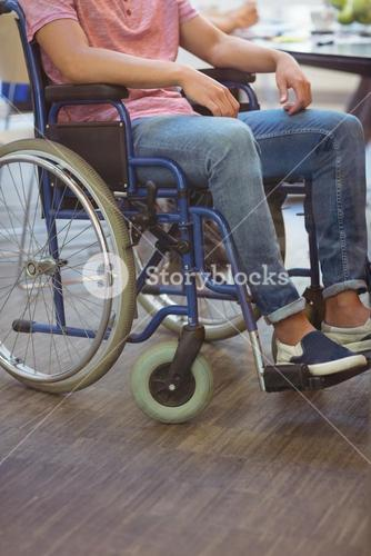 Handicapped business executive sitting in wheel chair