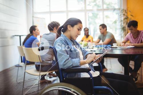 Handicapped business executive using digital tablet