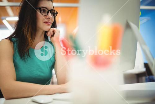 Beautiful female executive working at her desk