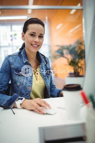 Portrait of beautiful female executive working at her desk