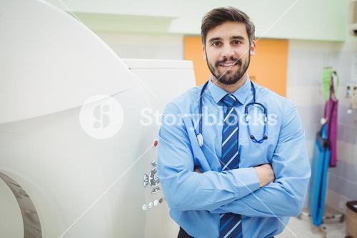 Portrait of doctor standing near mri scanner