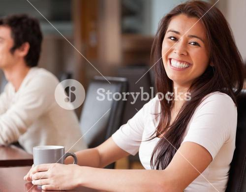Happy woman having a coffee