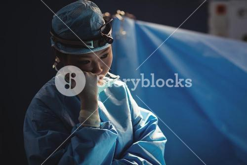 Female surgeon in operation room