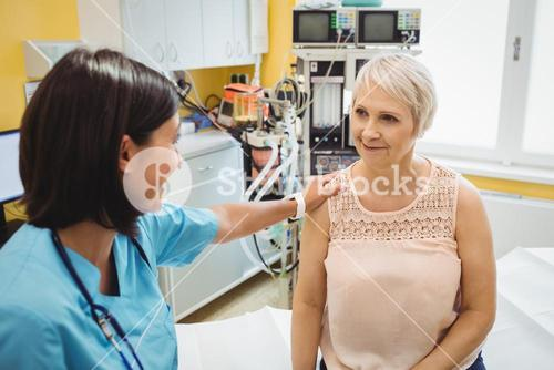 Female doctor consoling a patient