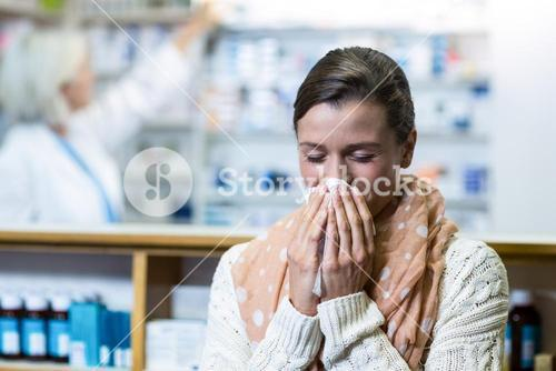 Customer covering her nose while sneezing
